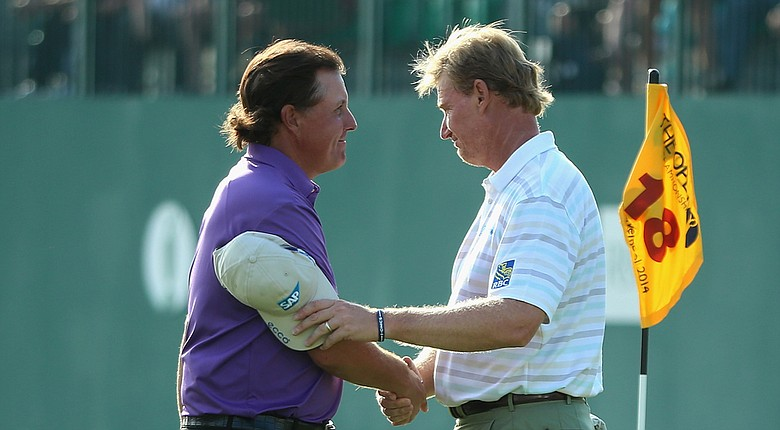Phil Mickelson and Ernie Els after their first round Thursday in the 2014 British Open at Royal Liverpool in Hoylake, England.