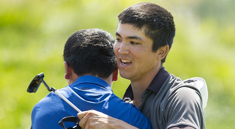 After winning the 2014 U.S. Amateur Public Links, Byron Meth (right) hugs runner-up Doug Ghim at Sand Creek Station Golf Course in Newton, Kan.