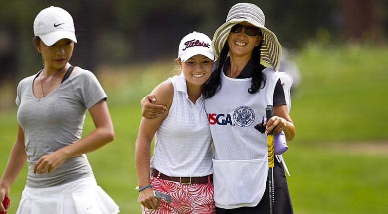 Mary Janiga and her caddie Jennifer Zhang celebrate a birdie at the sixth hole during the first round of match play of the 2014 U.S. Girls' Junior at Forest Highlands Golf Club in Flagstaff, Ariz.