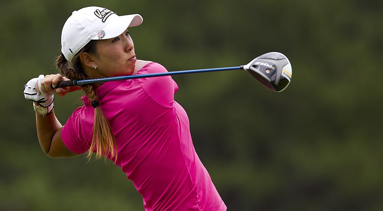 Cindy Ha plays her tee shot at the seventh hole during the third round of match play of the 2014 U.S. Girls' Junior at Forest Highlands Golf Club in Flagstaff, Ariz.