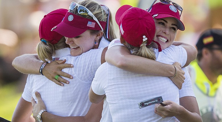 Stacy Lewis, Lexi Thompson, Cristie Kerr and Paula Creamer hug after winning their Day 2 matches at the LGPA International Crown at Caves Valley Golf Club.
