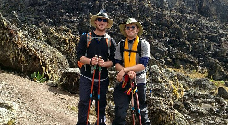 Erik Robinson and Devin Beck climbed Mount Kilimanjaro.