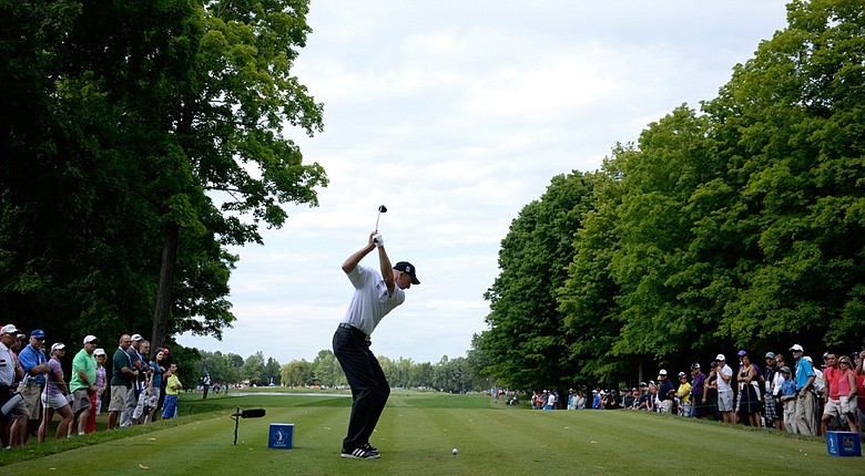 Jiim Furyk tees off on the 15th hole during the third round of the RBC Canadian Open at the Royal Montreal Golf Club.
