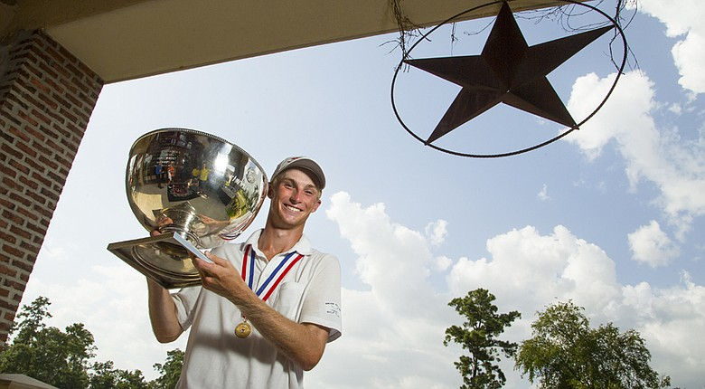 William Zalatories poses with the championship trophy after outlasting Davis Riley in the U.S. Junior Amateur final on Saturday.