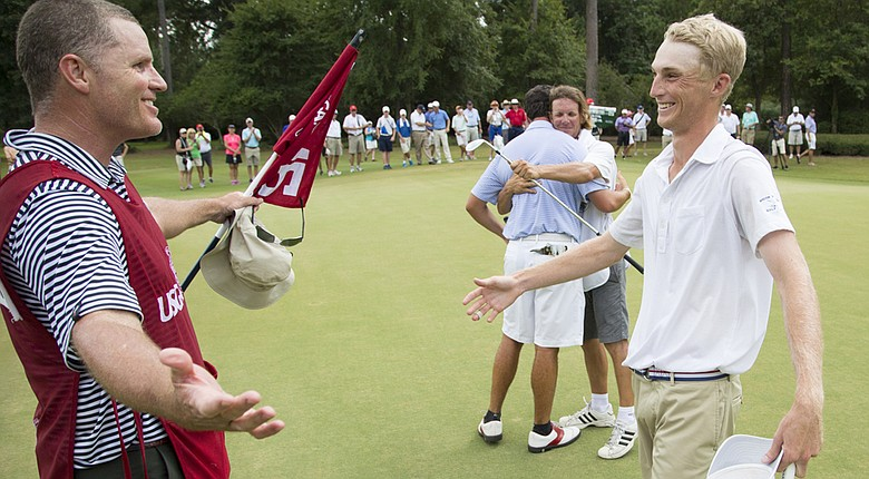 William Zalatoris and his caddie Scott Fawcett celebrate his victory on the 15th green on the 33rd hole of the final round of match play of the 2014 U.S. Junior Amateur at The Club at Carlton Woods.