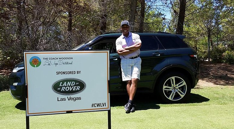 Jay Harris of ESPN after a hole-in-one won him a Land Rover SUV during a charity tournament in Las Vegas.