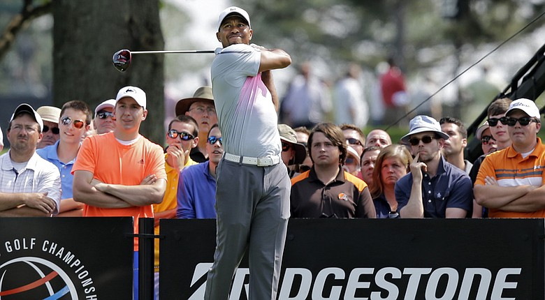 Tiger Woods watches his tee shot on the ninth hole during the first round of the WGC-Bridgestone Invitational.