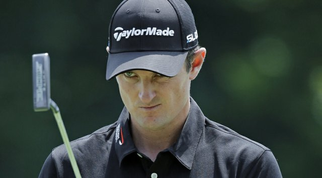 Justin Rose looks over his birdie putt on the ninth hole during the second round of the WGC-Bridgestone Invitational.