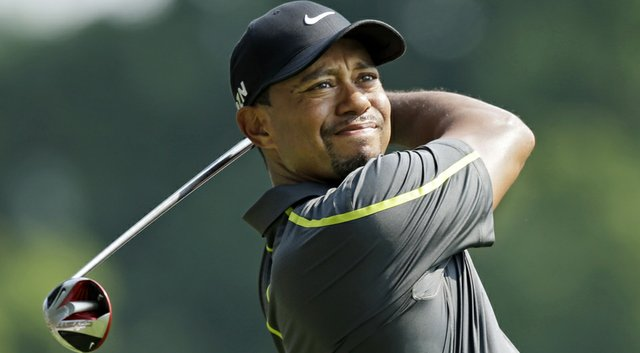Tiger Woods will play with Bubba Watson and Jimmy Walker in the third round of the WGC-Bridgestone Invitational on Saturday.