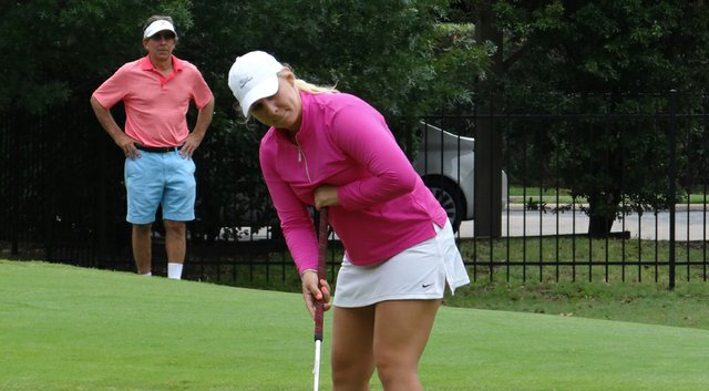 """Portland Rosen's father, """"Rocket,"""" looks on as she clinches the Texas Golf Association's Women's Amateur title."""