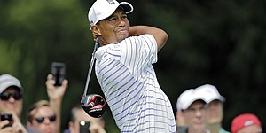 "Tiger reveals ""new"" driver in play at Bridgestone"