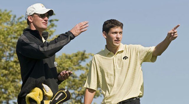 Mark Hankins, then coach of Iowa, confers with Brad Hopfinger at Golfweek's Conference Challenge.