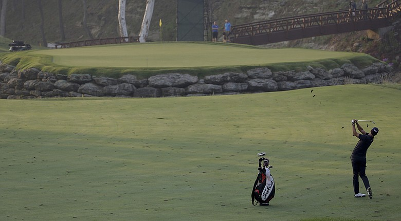 Adam Scott plays Valhalla's 13th hole Tuesday while practicing for the 2014 PGA Championship.