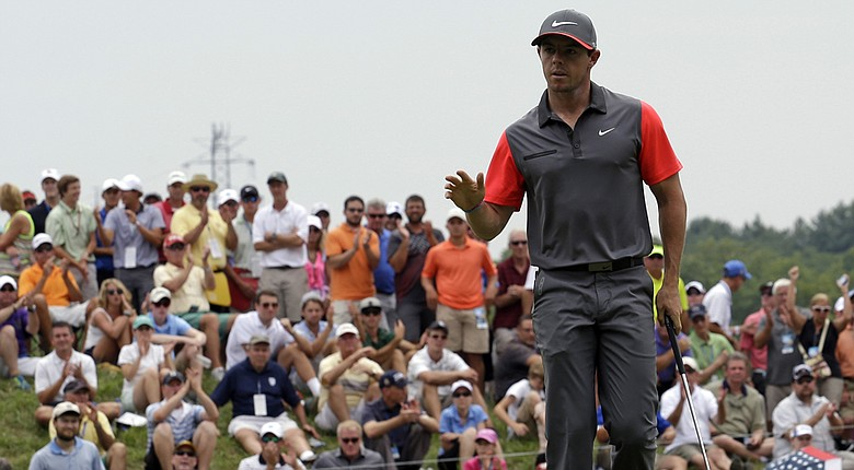 Rory McIlroy waves after a birdie on the fourth hole during the first round of the PGA Championship.