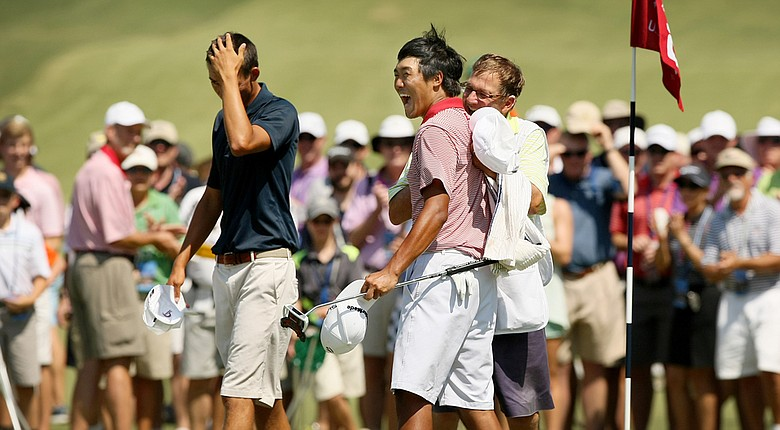 Gunn Yang celebrates his 19-hole victory over Frederick Wedel (left) with his caddie Richard Grice. Yang advances to Sunday's final at the U.S. Amateur, facing Corey Conners at 9 a.m.