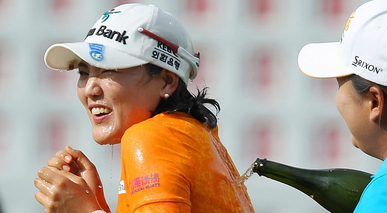 So Yeon Ryu wins the LPGA's 2014 Canadian Pacific Women's Open and is sprayed with champagne by fellow South Korean Inbee Park.