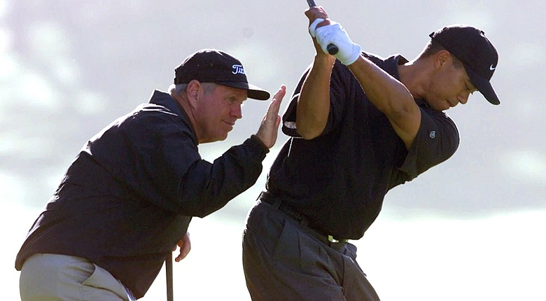 Tiger Woods gets instruction from coach Butch Harmon in 2000. The likelihood of a reunion seems to be a long shot.
