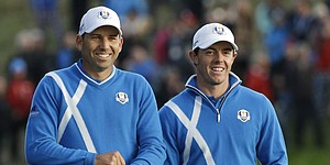McIlroy, Garcia rally late for afternoon halve
