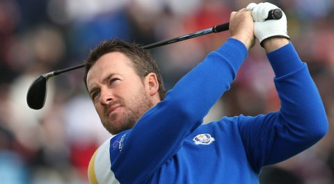 Graeme McDowell plays a shot off the third tee during his singles match against Jordan Spieth at the Ryder Cup.