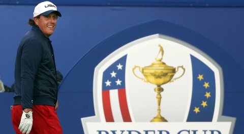 Phil Mickelson walks to the first tee before his match with Stephen Gallacher.
