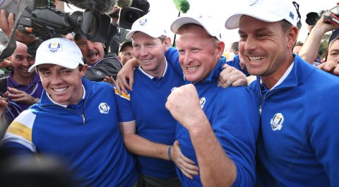 Europe's Rory McIlroy, Stephen Gallacher, Jamie Donaldson and Henrik Stenson celebrate winning the 2014 Ryder Cup.