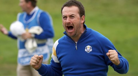 Europe's Graeme McDowell celebrates on the 17th green after winning his singles match against Jordan Spieth, a match that Spieth led 3 up.