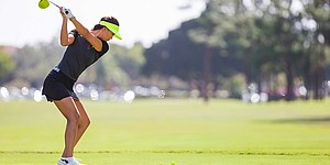 Michelle Wie using all-yellow Nike driver and ball