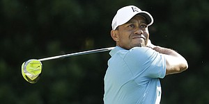 A fist pump for the weekend: Tiger Woods makes Players cut