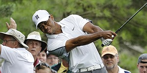 Tiger Woods scrambles well at Muirfield despite wild tee game