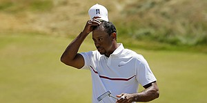 Tiger exits U.S. Open after minimal improvement from opening 80
