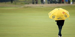 Early showers send Tiger back to bed, but expect 'heavy rain' Friday at British Open