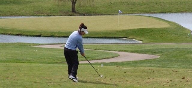 Jasmine Ly hits an approach shot during her victory at the UK Club.