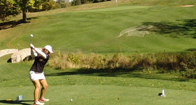 Girls 15-19 winner Grace Mitchell hits an approach during her round at Forest Akers.