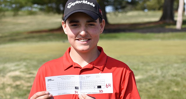 Drew Salyers displays his record-setting scorecard at Harmony Landing.