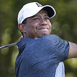Tiger Woods keeps momentum with 66 at Quicken Loans National
