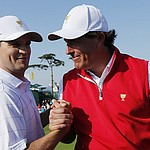 Opposites attract as Mickelson and Johnson click in U.S. victory