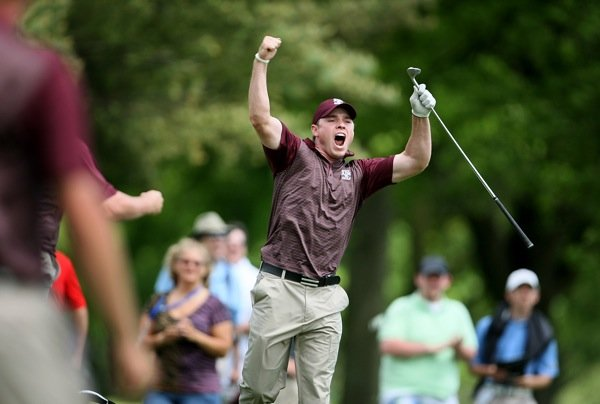 Texas A&M's Bronson Burgoon reacts to knocking his 120-yard second shot from the fairway at No. 18 to within inches of the hole to win the national championship.