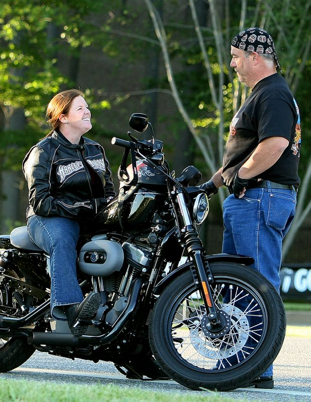 UCF golfer Stephanie Connelly and her dad, Mike, on their Harley-Davidson during the 2009 NCAA Women's Golf Championships at Caves Valley Golf Club in Owings Mills, Md.