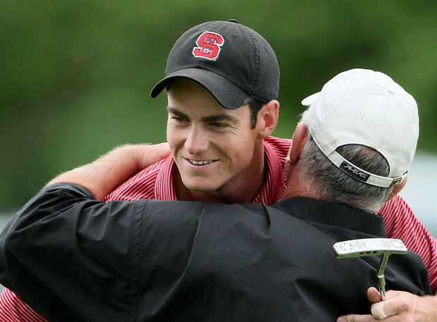 N.C. State's Matt Hill hugs his coach, Richard Sykes, after winning the 2009 NCAA individual title.