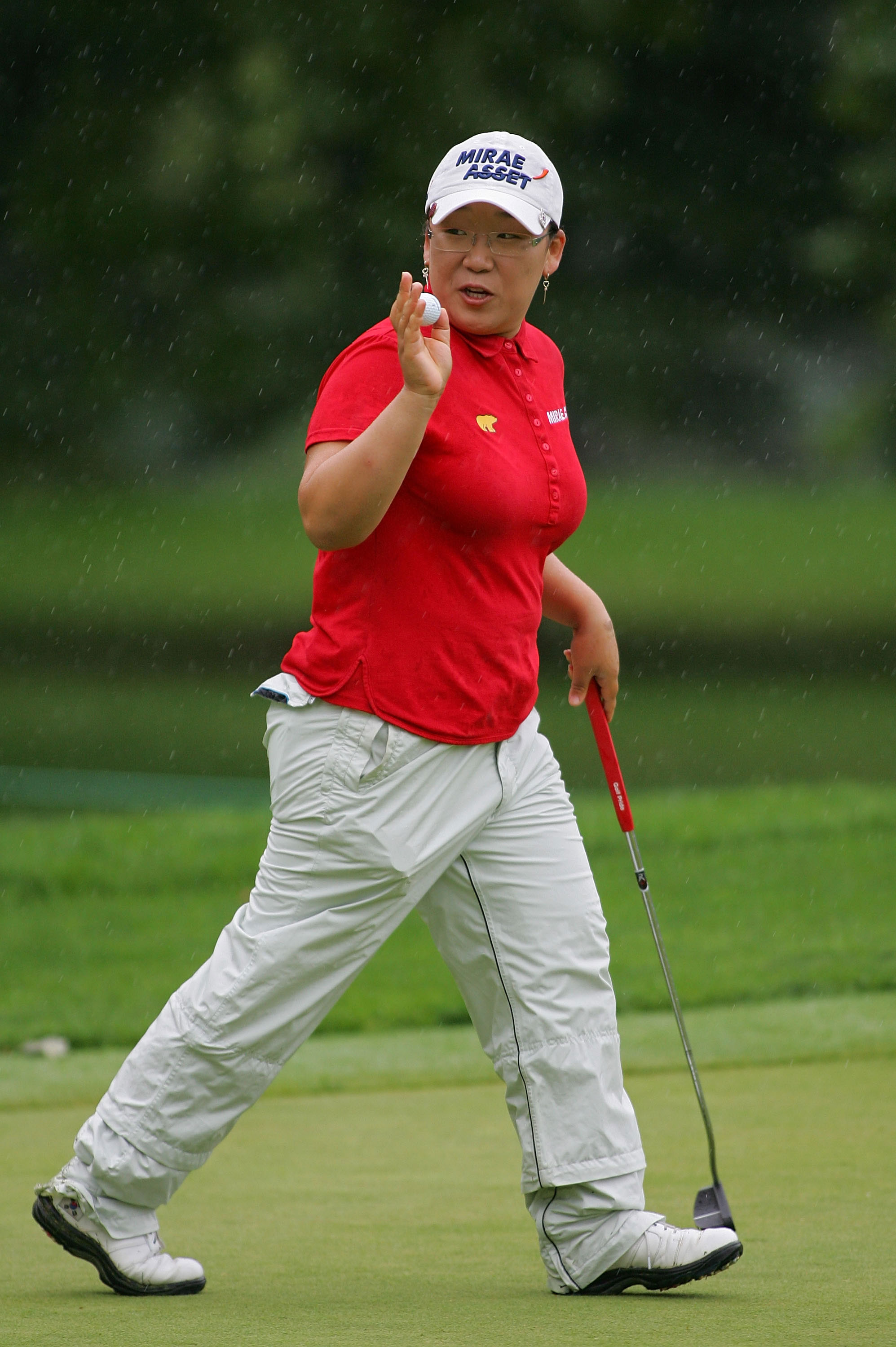Jiyai Shin acknowledges the gallery after making birdie on the 17th green during the final round of the Wegmans LPGA.