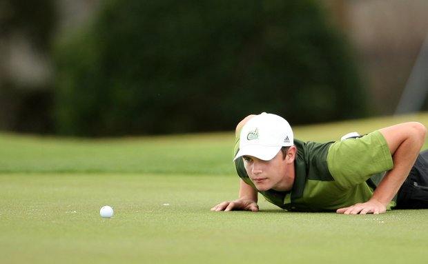 Corey Nagy of Charlotte lays down for a better view on the 8th green during Monday's round of the John Hayt Collegiate Invitational at Sawgrass Country Club in Ponte Vedra Beach, FL.