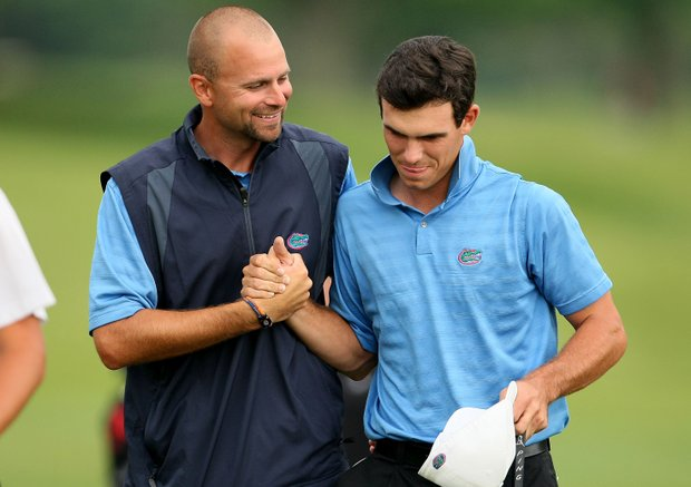 Florida assistant coach Steve Bradley congratulates SEC champion Billy Horschel.