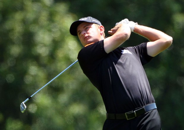 John Merrick hits his approach shot on the first hole during the final round of the 2009 Masters Tournament.