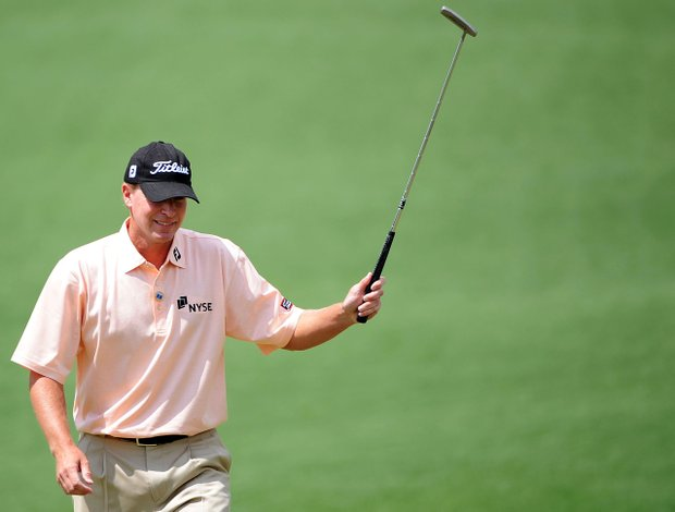 Steve Stricker waves as he walks across the second green during the third round of the Masters.