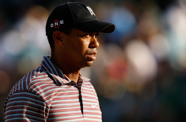 Tiger Woods walks off the 18th hole during the second round of the Quail Hollow Championship.