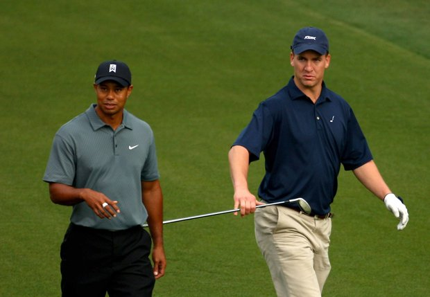 Indianapolis Colts Quarterback Peyton Manning walks with Tiger Woods during the Pro-Am for the Quail Hollow Championship.