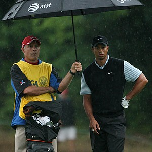 Tiger woods surveys a shot with caddy Steve Williams.