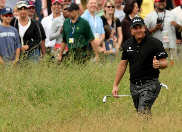 Phil Mickelson walks to the 17th green during the continuation of the third round of the 109th U.S. Open.