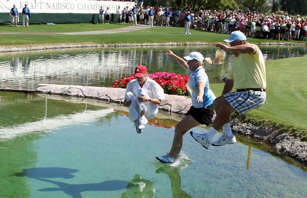 Brittany Lincicome (center) leads her father Tom (right) and caddie Tara Bateman into the lake after winning the 2009 Kraft Nabisco Championship.
