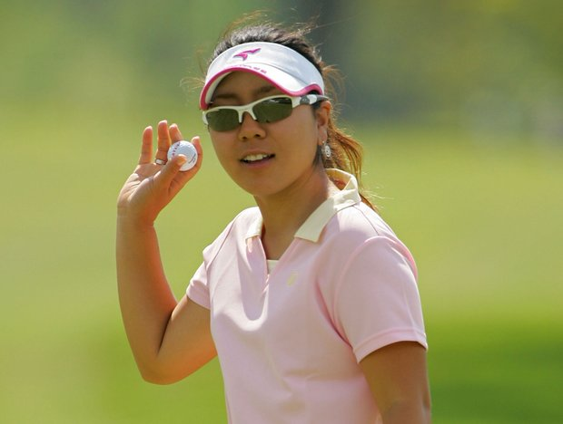 Mika Miyazato of Japan celebrates her birdie on the 18th green to take the lead during the third round of the LPGA Corning Classic.